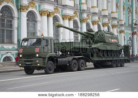 SAINT PETERSBURG, RUSSIA - MAY 07, 2017: Heavy military truck KAMAZ-65225 with self-propelled artillery Msta-s on the trailer. Preparations for the parade in honor of Victory Day