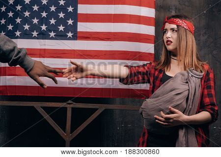 Child without a father. Break of family relations. Sad wife and husband on USA national flag background. Divorce, social problem, father leaving, youth pregnancy concept