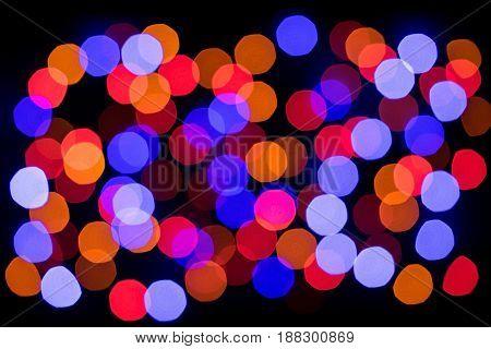 Decorative multicolour bubbles, Christmas concept. Light effekt on black background