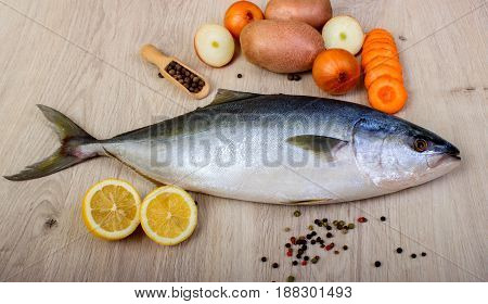 Fresh Fish With Lemon, Parsley And Spice On Wooden Cutting Board Isolated