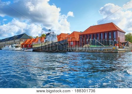 The Houses With Red Roofs Near Harbour In Copenhagen.