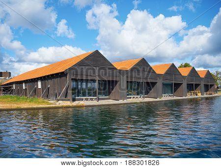 A Red Roof Houses Near Harbor In Copenhagen, Denmark