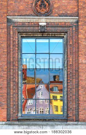 The Window Reflection Of Nyhavn Townhouses In Copenhagen.