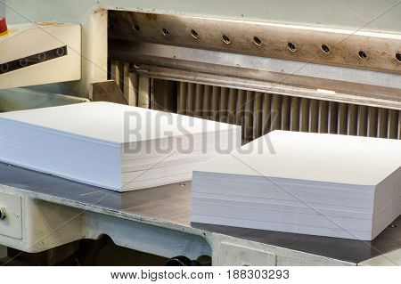 Reams Of Cut Paper Pages On A Cutter Machine