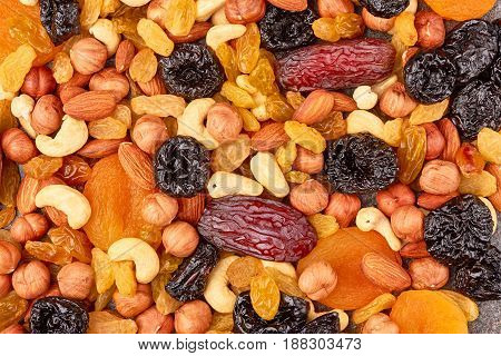 Mix of dried fruits and nuts background concept