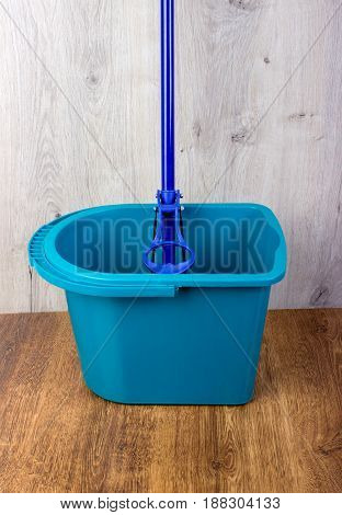 Mop And Blue Bucket