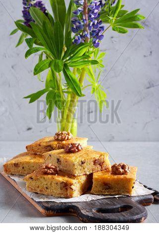 Walnut and honey cake sliced on board