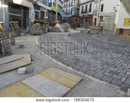 Alora Spain - May 15 2017: Square paving stones awaiting grouting in village street in Andalusia