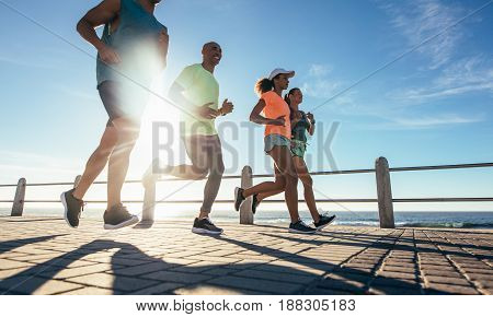Young Runners Workout On The Sea Front Path