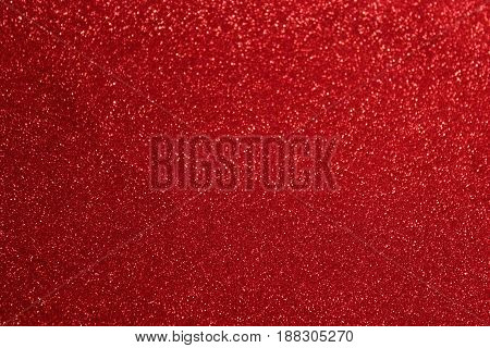 Red shiny fabric. Abstract festive background. Red texture for christmas