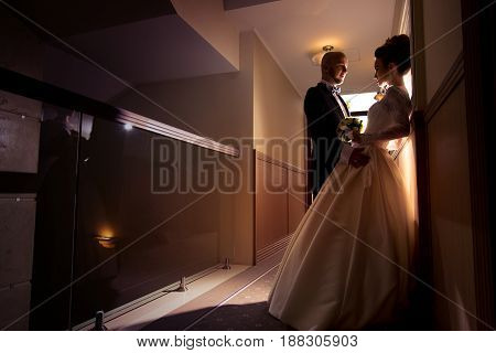 silhouette portrait of young just merried couple