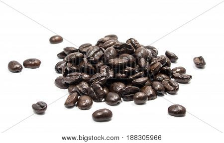 Coffee beans on a white background Roasted nuts on a white background Soft focus