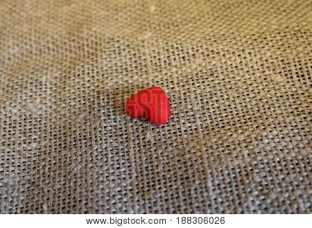 Red textured hearts on unpainted canvas. Valentine