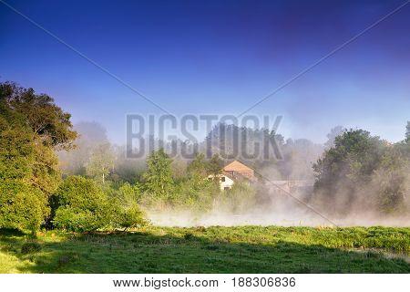 Misty Morning On The River. Foggy River Landscape