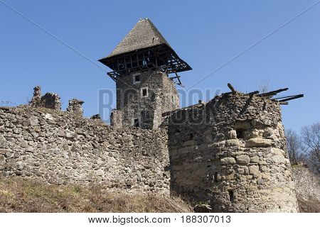 Ruins of Castle Nevytske near of Transcarpathian region center Uzhgorod photo. Nevitsky Castle ruins built in 13th century. Ukraine.