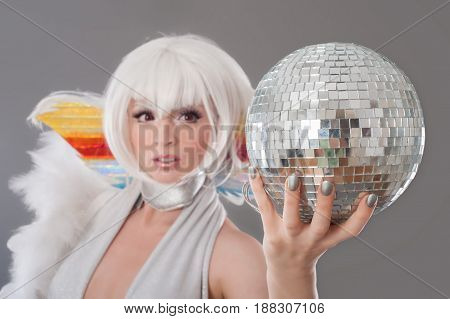 Glamour And Sensual Lady Holding Disco Ball In Luxury Dress