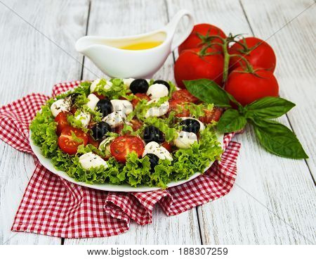 Salad With Mozarella Cheese And Vegetables