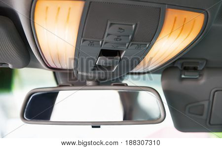 Car rearview mirror. Car interior detail. Close-up