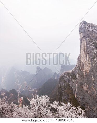 TianMen mountain viewpoint from cliff hanging walkway. TianMen mountain is located in Zhangjiajie, China. January 2017.