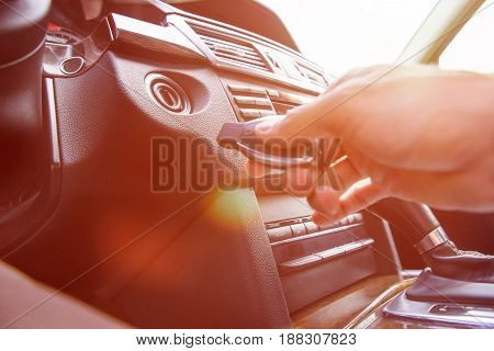 Close-up Of Person's Hand Inserting Key To Start Car. Sunlight.