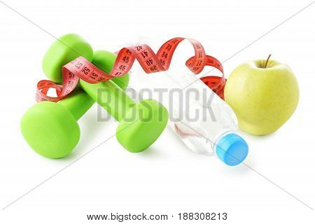 Green Dumbbells, Green Apple, Bottle And Tape Measure Isolated On White