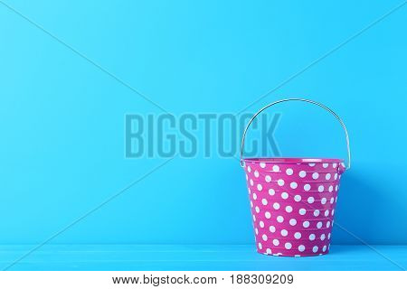 Pink bucket on the blue background, close up