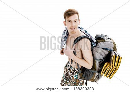 Portrait of young hiker with a backpack on a white background