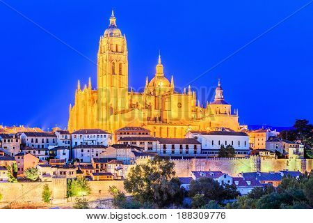 Segovia Spain. View over the town with its cathedral and medieval walls at twilight.