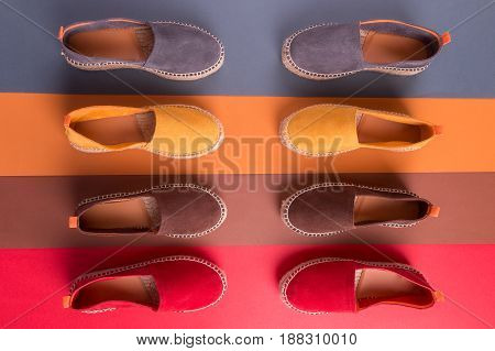 Loafers on multicolor background. Top view. Four pair