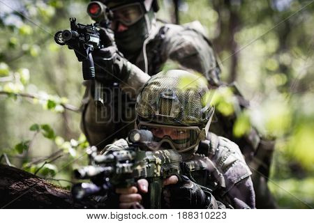 Photo of snipers on exploration in woods during day