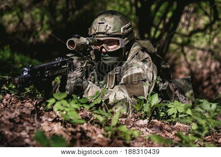 Photo of soldier in ambushed at woods by day