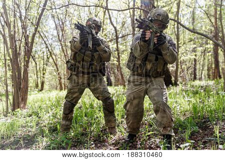 Photo of soldiers on reconnaissance with machine guns