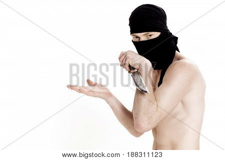 ninja man holds a knife and is ready to attack on a white background