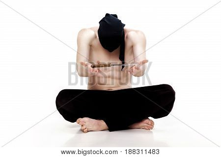 ninja man holds a knife a white background