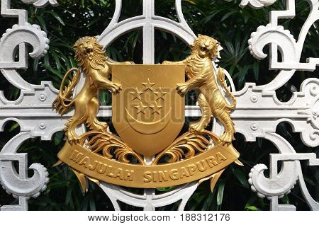SINGAPORE- MAY 01 2017: Entrance of the Istana of the Republic of Singapore with a logo.