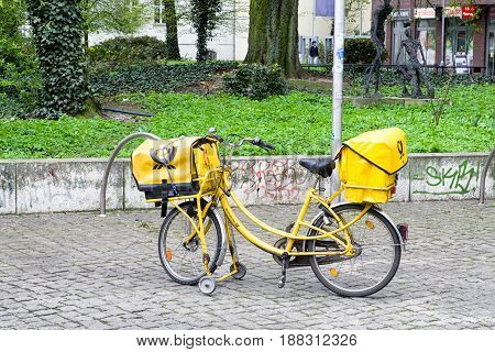 BERlIN GERMANY - APRIL 7: Yellow bicycle of postman from Deutche post on April 7 2017 in Berlin