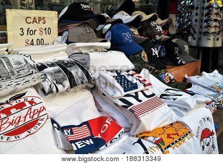 New York City Souvenir T-Shirts For Sale. New York City, NY, USA - June 29, 2014. A street view of a typical souvenir shop in Manhattan with t-shirts and baseball caps for sale