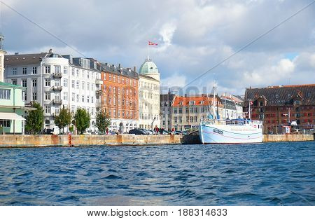 COPENHAGEN DENMARK - AUGUST 22 2014: Havnegade is a waterfront promenade in Copenhagen Denmark which runs between Bors Brisge and the mouth of the Nyhavn canal.