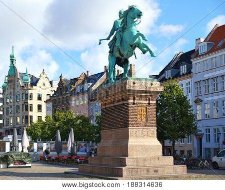 COPENHAGEN DENMARK - AUGUST 22 2014: Statue of Bishop Absalon on the Hojbro Plads. Bishop Absalon (1128 - 1201) is considered the founder of Copenhagen (1167). The statue was raised in 1902 - and created by sculptor Vilhelm Bissen in bronze.