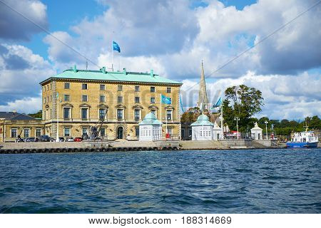 COPENHAGEN DENMARK - AUGUST 22 2014: Dahlerup's Port Authority Building with the two Royal Pavilions. It marks the western boundary of the quayside space at Nordre Toldbod.
