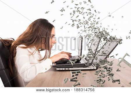 Woman on the computer writes frantically. internet and social network addiction