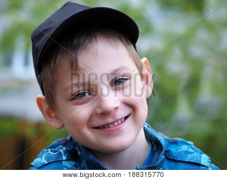Portrait of a boy. Baby smiling kind happy smile