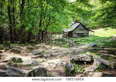 Pioneer Log Cabin. Log cabin in a lush mountain valley in the Great Smoky Mountains National Park. This cabin is a historical display in a national park not a privately owned property or residence