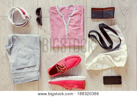 Set of men's clothes consist of jeans, sneakers, T-shirt, bag, belt, sunglasses, wallet and mobile phone