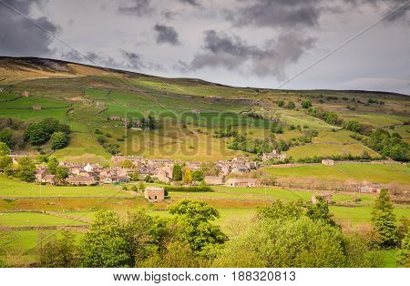 Gunnerside Village in Swaledale - Swaledale in Yorkshire Dales National Park winds into the northern Pennines. It is famous for its meadows field barns and drystone walls.