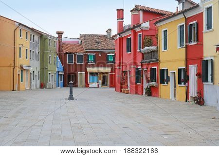 Small empty square with colorful facade houses