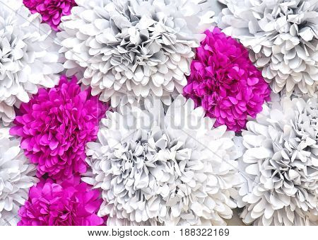 Decorative fake flower leaves background with pink details