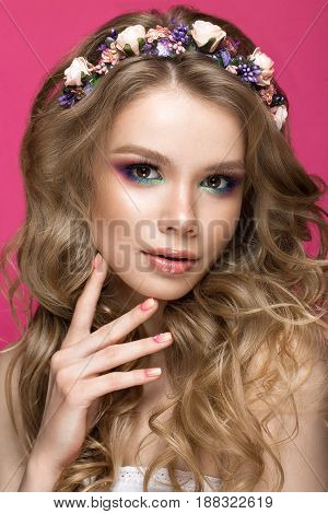 Portrait of a beautiful blond girl in image of the bride with purple flowers on her head. Beauty face. Photo shot in the Studio.