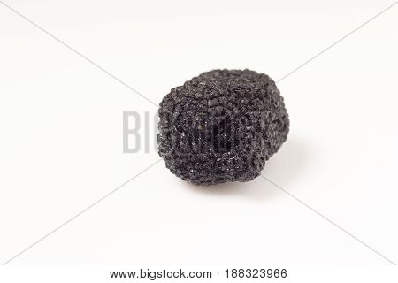 Delicate exclusive black truffles isolated on white background
