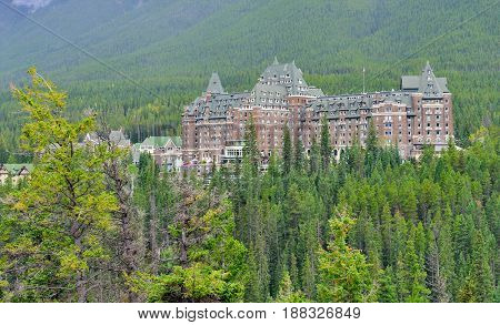 The Fairmont Banff Springs Hotel And Spa In Banff Springs, Canada During A Foggy Day